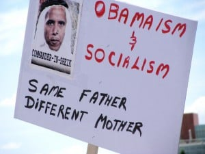 Sign showing Obama as a foreigner at a town hall in Albuquerque, August 2009. (Photo by Marjorie Childress)