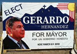 Gerardo Hernandez, shown here in a campaign sign, is the alleged victim of the extortion plot. (Photo by Heath Haussamen)