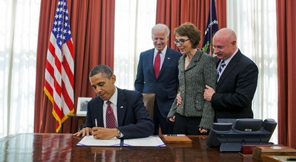 President Obama signs the Ultralight Aircraft Smuggling Prevention Act into law, accompanied by Rep. Gabrielle Giffords, sponsor of the legislation in the House.