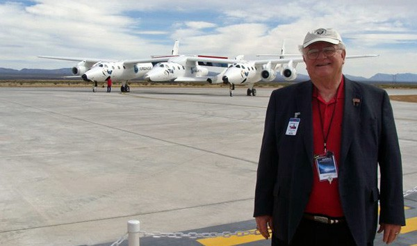 Evans, shown here at Spaceport America with Virgin Galactic's SpaceShipTwo, which is being carried in this photo by its mothership, White Knight Two.