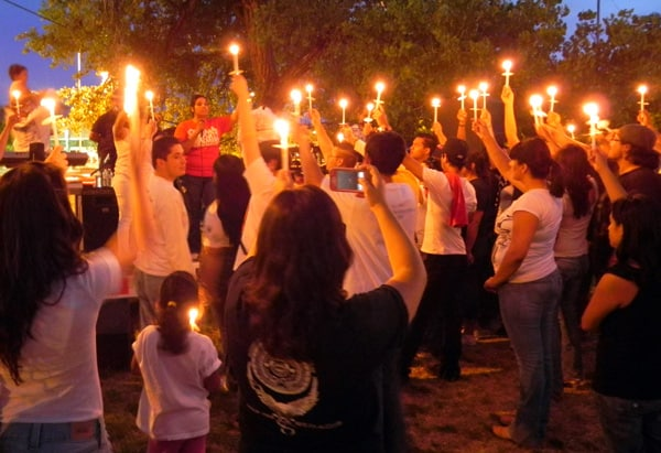 "Albuquerque's May Day march ended with people lighting candles and students sharing their dreams for a prosperous New Mexico. Santa Fe College student LuzHilda Campos said, ""We represent our parents' American Dream, and we are working hard to make sure that their sacrifices haven't been made in vane."" (Photo courtesy El Centro de Igualdad y Derechos)"